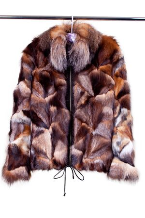 woman in fur coat: close up shot of woman fur coat isolated on white Stock Photo