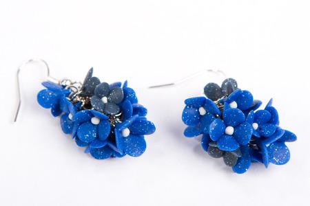 blue rose earrings beautiful handmade earrings isolated on white background photo