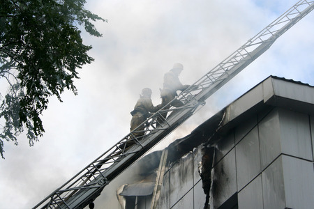 fireman wearing a gas mask on the stairs photo