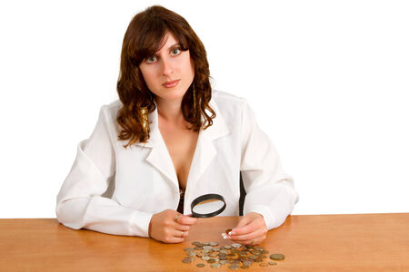Financial concept, hand hold magnifying glass and coins photo
