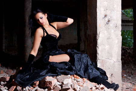 trash the dress: Young beautiful woman posing in ruins after fire