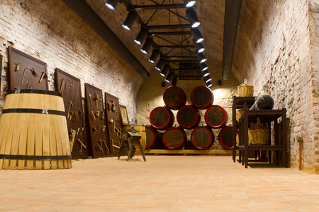 manufacture of wooden barrels in the factory,wine barrels with a candle in a cellar