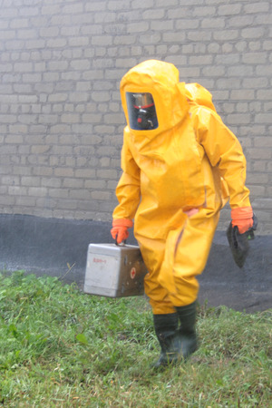Man in chemical protection suit, carrying out the decontamination area Standard-Bild
