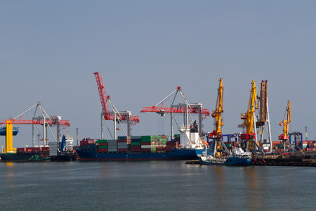 Cargo crane, ship and grain dryer in port Odessa, Ukraine