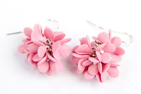 rose earrings beautiful handmade earrings isolated on white background photo