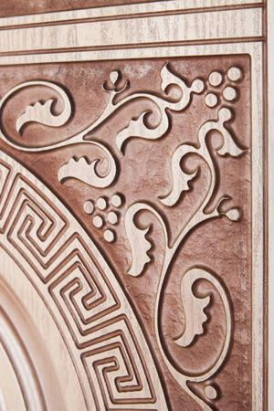 isolaten: fragment beautiful carved brown wooden door with an emphasis on design