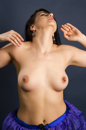 bare breasts: Fashion photo of beautiful nude woman with sexy tan body on dark background Stock Photo