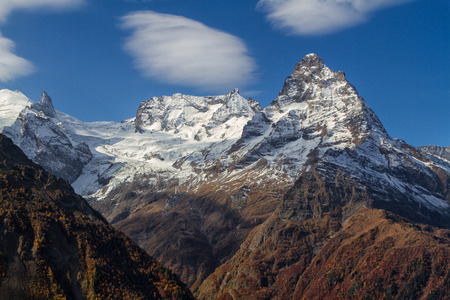 dombai: Landscape of mountains Caucasus region in Russia Mountain peaks in clouds. Caucasus. Dombay.