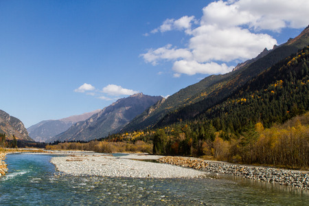 dombai: The mountain rivers of the Caucasus. Protected areas of the Caucasus in the vicinity of the village of Dombay