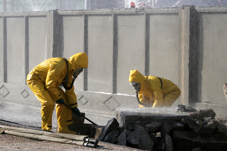 Man in chemical protection suit, carrying out the decontamination area 스톡 콘텐츠