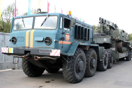 armoured: An old Soviet Armored troop-carrier on the street Armoured personnel carrier