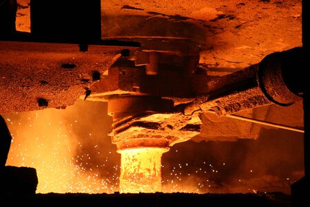 Metal casting process with high temperature fire in metal parts factory Stock Photo