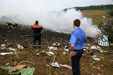 fatal: Firemen attending the scene of a fatal airplane crash with thick gray acrid smoke.