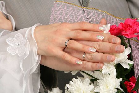 betroth: Hands of the groom and the bride with wedding rings