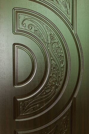 view of a wooden doorway: fragment beautiful carved brown wooden door with an emphasis on design