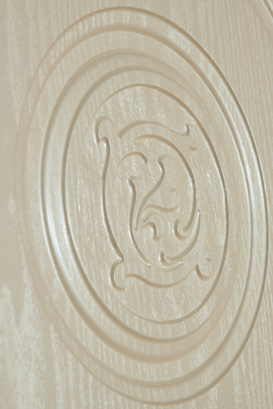 emphasis: fragment beautiful carved  wooden door with an emphasis on design Stock Photo