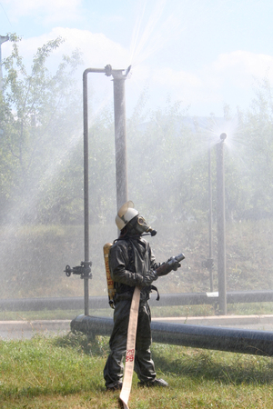 gasmask: firefighters in chemical protection suit during the job