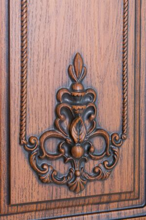 emphasis: fragment beautiful carved brown wooden door with an emphasis on design