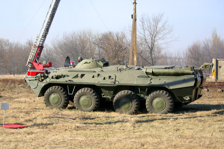 animals amphibious: An old Soviet Armored troop-carrier on the street Armoured personnel carrier