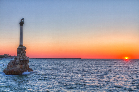 Sevastopol Monument to the scuttled ships on a background sunset