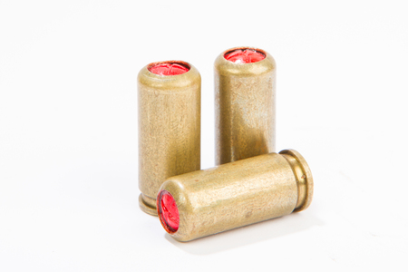 a couple of bullets on a white background ammunition of rifled carabine Stock Photo