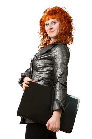 businesswoman using laptop computer, smiling. Isolated on white background. photo