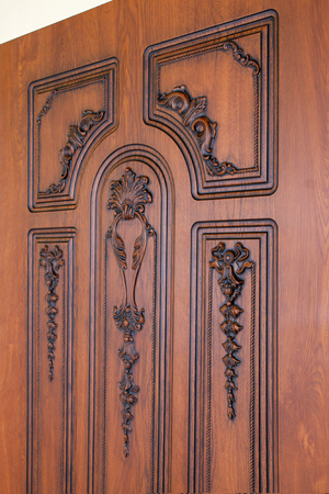 fragment beautiful carved brown wooden door with an emphasis on design