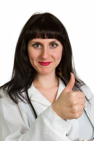 Happy smiling cheerful female doctor with thumbs up gesture, on a white background