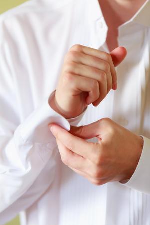 cufflink: shirt groom hands buttoning married people men style