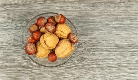 Assorted mixed nuts on white background almond hazelnut walnut Imagens