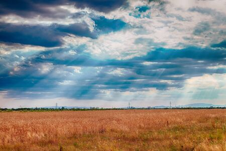 atmosphere: dramatic blue sky with clouds and sun rays climate atmosphere