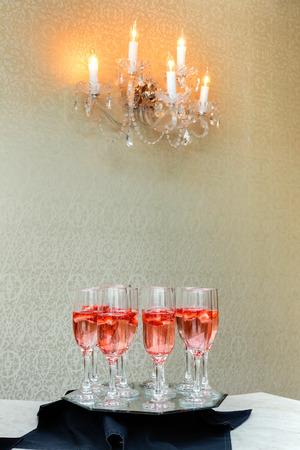 Strawberry splashing into a glass of champagne celebration