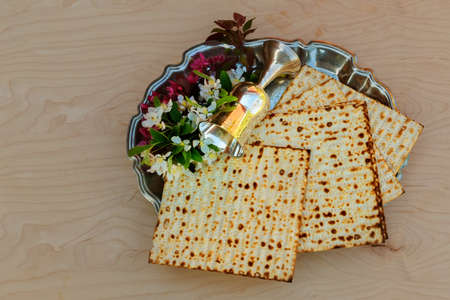 matzot: Top view and matzoh jewish passover bread over wooden background.
