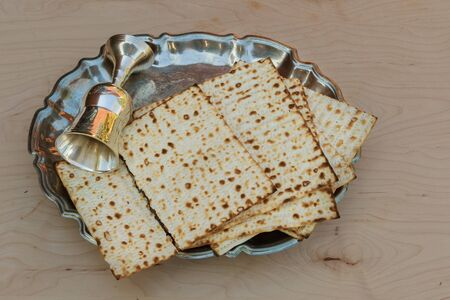 matzos: Top view and matzoh jewish passover bread over wooden background.