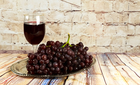 aligote: glass of wine and grapes, isolated on white  wine grapes