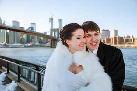 Gorgeous wedding couple, bride and groom posing on bridge in Krakow
