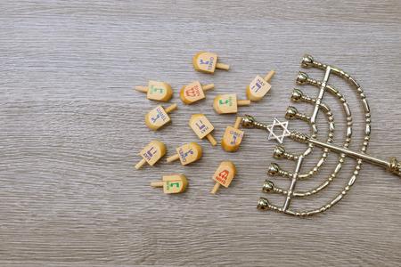 Menorah on wooden table. Hanukkah holiday symbol.