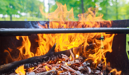 black burned charcoal bbq grid fire natural as background