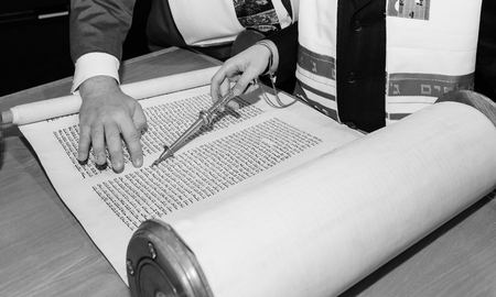 Jewish man dressed in ritual clothing family man mitzvah jerusalem
