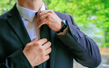 Hands of wedding groom getting ready in suit hand groom bride preparing for the wedding Stock Photo