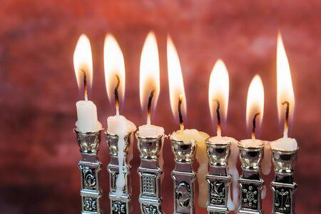 menora: Image of jewish holiday Hanukkah background with menorah traditional candelabra and Burning candles