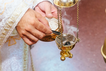 house robes: censer church rite foog priest singing in a christian sermon