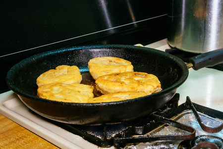tat: cooking deep fried meat pies frying Tat Stock Photo