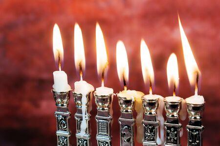 hanuka: Image of jewish holiday Hanukkah background with menorah traditional candelabra Burning candles menorah, hanuka Stock Photo