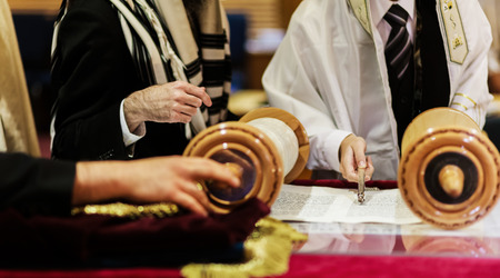 bar mitzvah: Hand of boy reading the Jewish Torah at Bar Mitzvah reading Jewish books