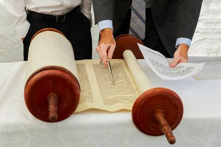 5 SEPTEMBER 2016 USA NY Hand of boy reading the Jewish Torah at Bar Mitzvah Bar Mitzvah Torah reading