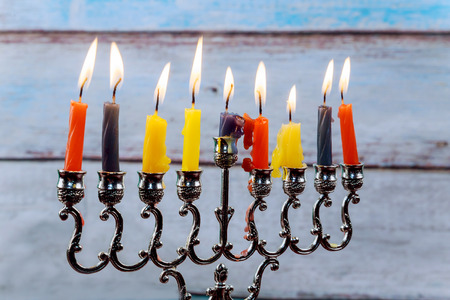 jewish holiday Hanukkah with menorah traditional and wooden dreidels spinning top . glitter overlay Reklamní fotografie