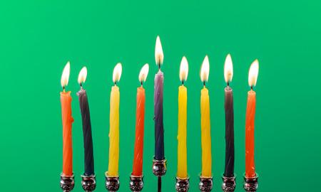 judaic: Hanukkah menorah with candles Hanukkah candles happy burning green background isolation