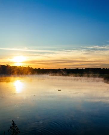 earlier: earlier morning on the river fog in the morning on the river Stock Photo