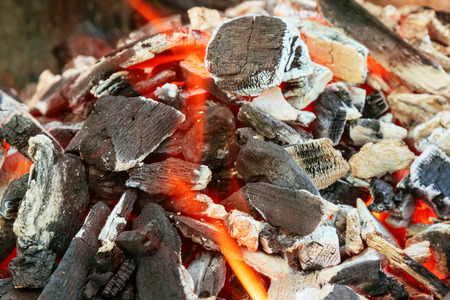 Burning Charcoal in BBQ Close-up, with space for text or image.